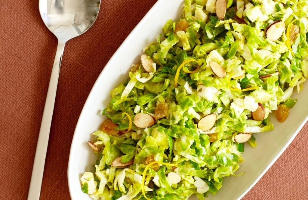 Shredded Brussels Sprouts with orange and almonds close up