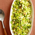 Shredded Brussels Sprouts with Orange and Almond in an oval dish