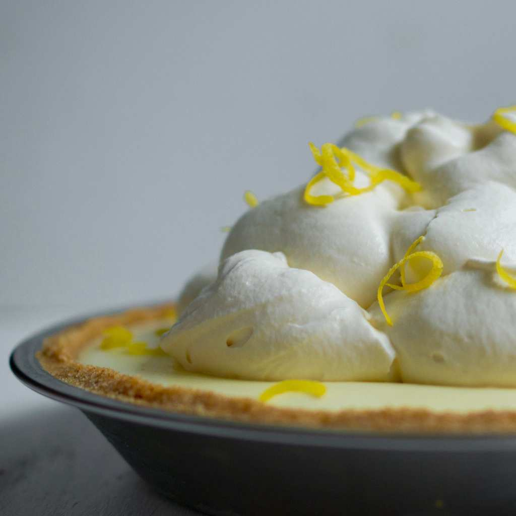 Delicious lemon no-bake icebox pie with mounds of whipped cream