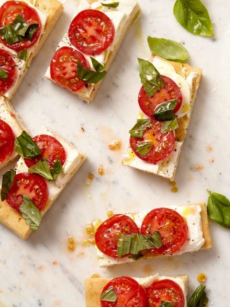 Caprese Focaccia cut on marble background