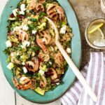 Grilled shrimp and zucchini couscous dinner on blue plate