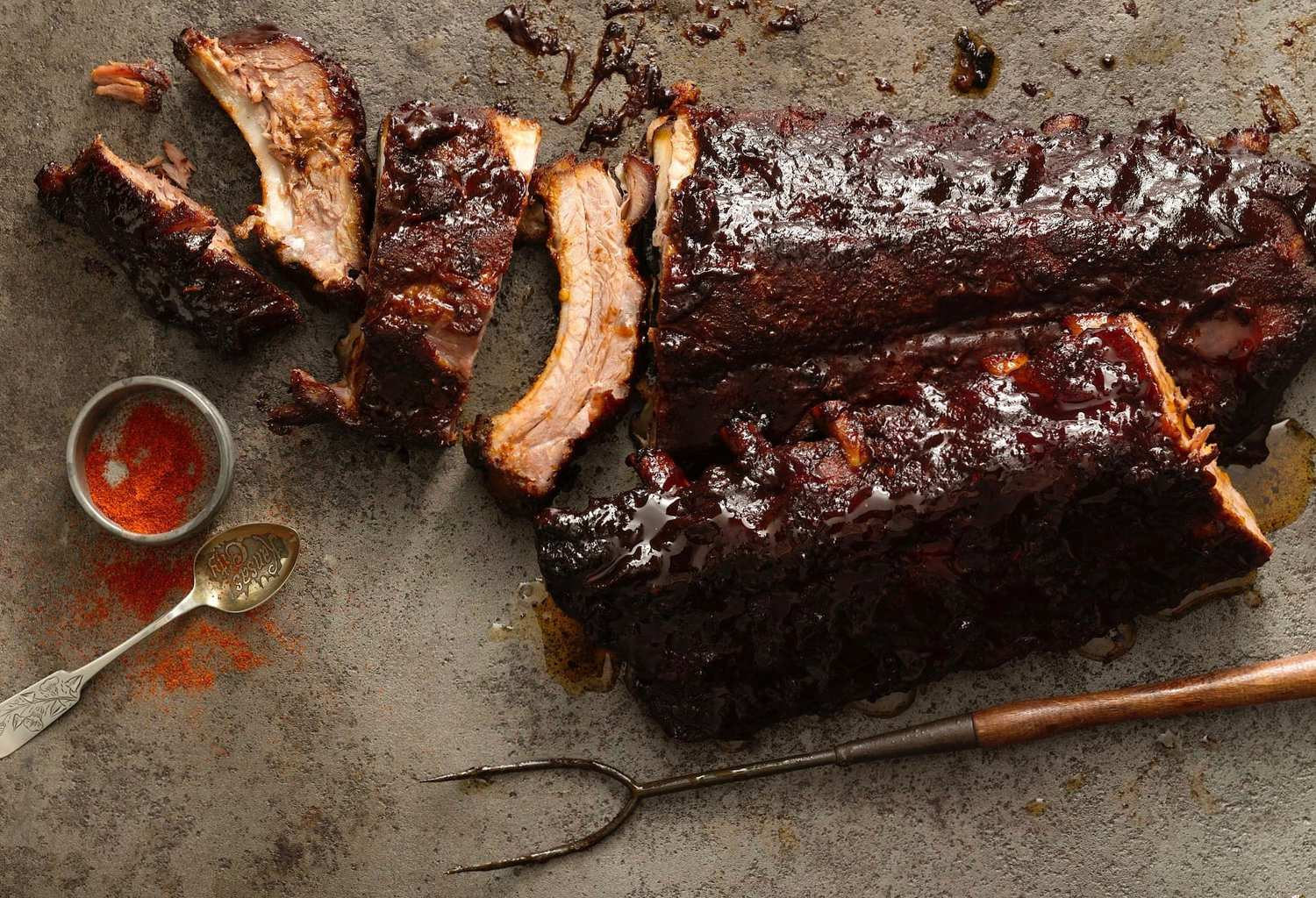 BBQ ribs on gray background, w fork