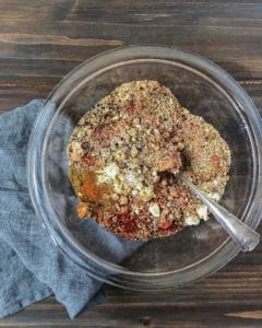 10 ingredient bbq rub ingredients in clear glass bowl