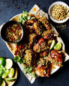 sticky sweet chili chicken with pistachios on platter