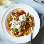 Italian Tomato and Eggplant Skillet Pasta in white bowl