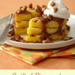 Grilled Pineapple Praline stacked on white plate with whipped cream pin image