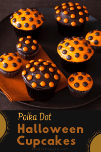 brown and orange Polka Dot Halloween Cupcakes on orange napkin