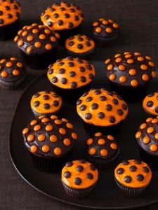 halloween cupcakes on black surface