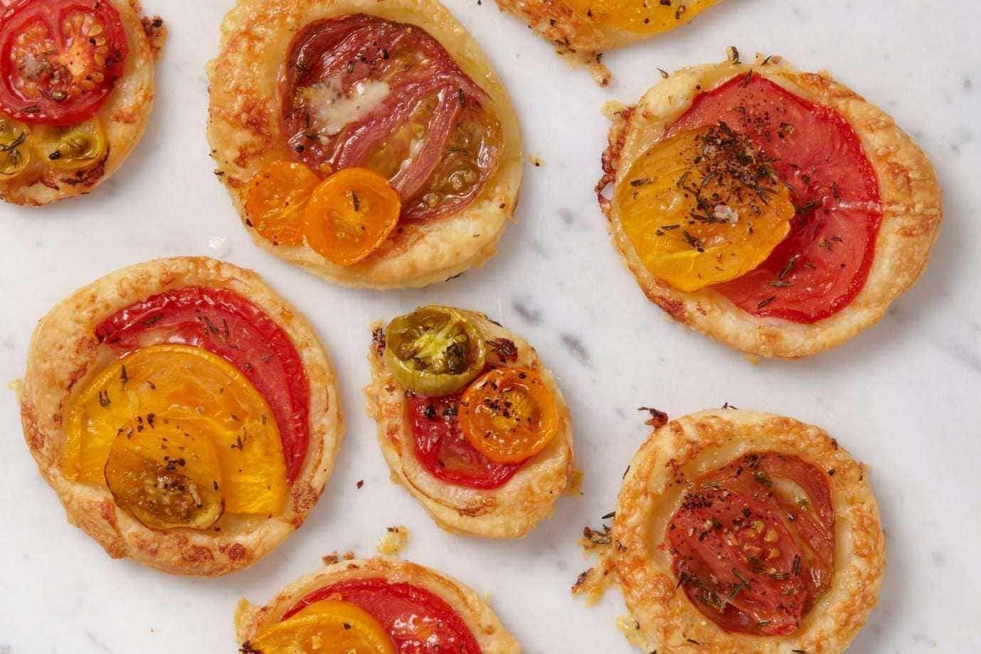 mini tomato tart recipe on white marble
