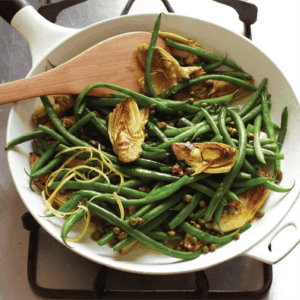 close up of sautéed green beans and artichoke hearts