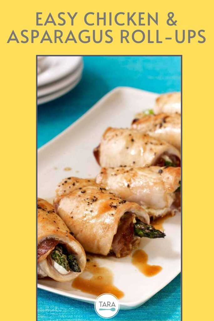 chicken and asparagus roll ups on serving dish blue background