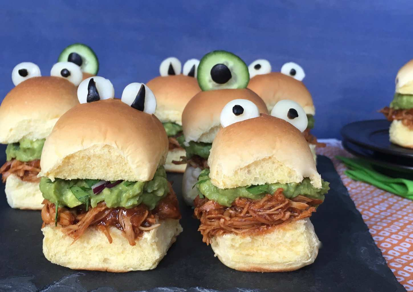 Halloween monster chicken sliders on a black slate