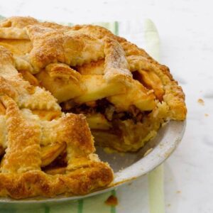 apple pie with pecan streusel on green linen