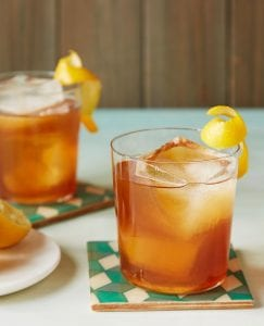 Earl Grey Tea Cocktail with lemon curl and rum