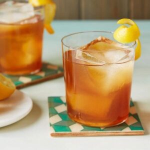 An Earl Grey Cocktail is a sophisticated tea cocktail with a lemon curl