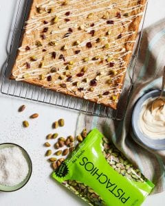 Wonderful Pistachios and Cherry Cookie Bars with bag of pistachios