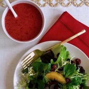 Winter Salad with oranges and bowl of cranberry vinaigrette