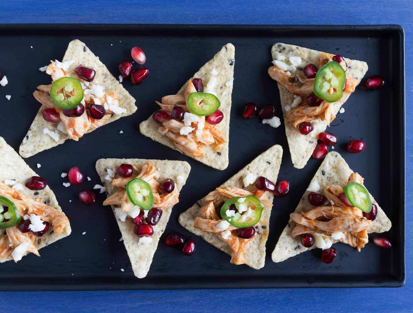 Instant Pot chipotle pomegranate taco bites on slate and blue