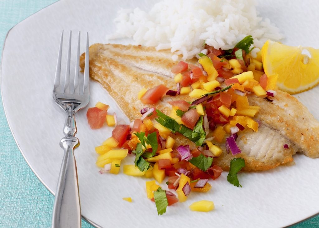 make fish with mango salsa for dinner on a plate with a fork