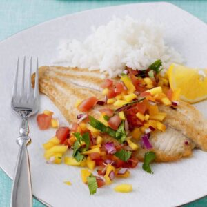 fish on a plate with mango salsa