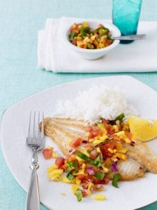 fish with mango salsa and white rice on white plate