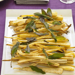 Roast Parsnips on a platter with fried sage