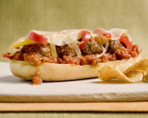 close up of delicious open face meatball sub on a cutting board