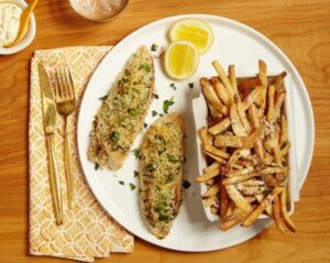 Crispy Lemon Fish on a plate with Parmesan Fries