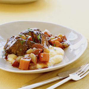 short ribs with polenta in a bowl