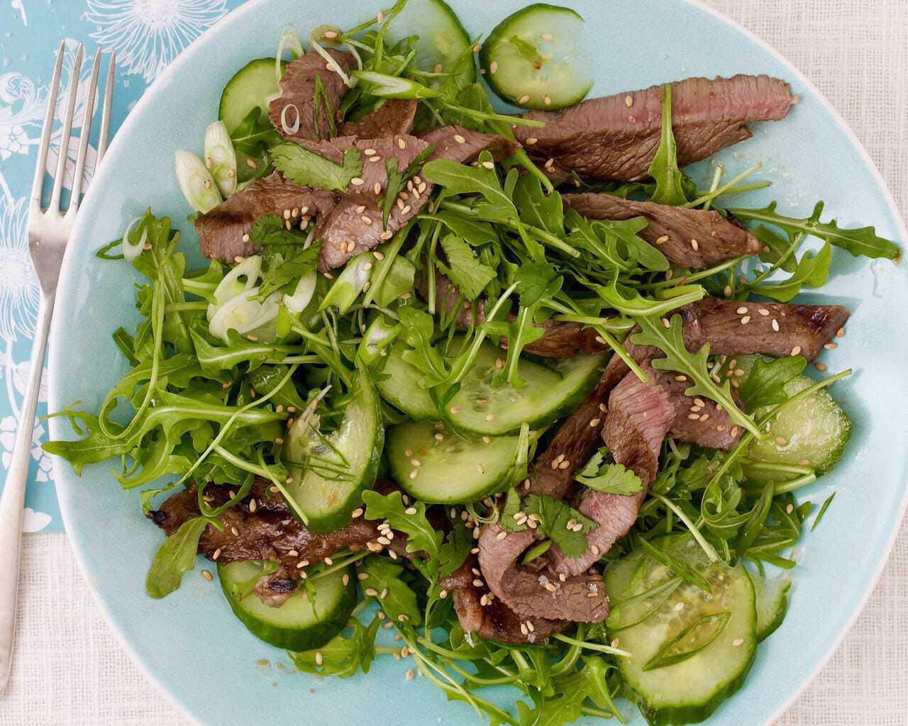 Sesame Ginger Beef Salad in turquoise bowl overhead