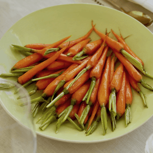 Brown Sugar and White Wine glazed carrots in green bowl