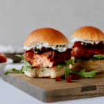 bite out of salmon slider on cutting board