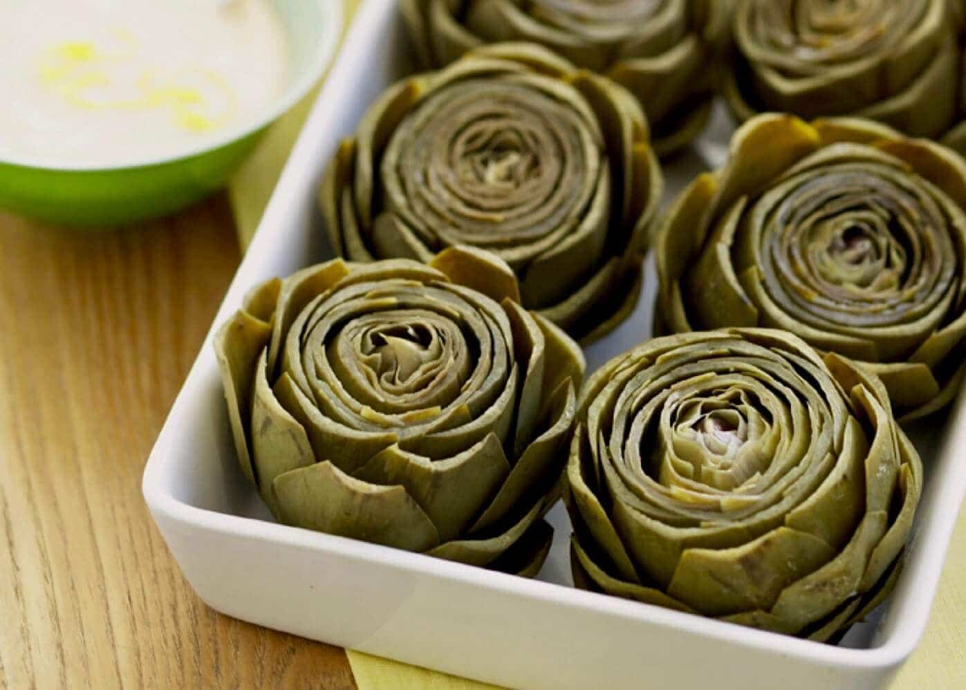 artichokes in white dish with lemon mayo