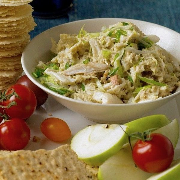 Curry Crab dip spread with apples, tomatoes, and crackers.