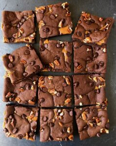 Gooey caramel brownies on a slate