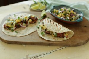 Blackened Salmon Tacos with jalapeno crema and red onion pineapple