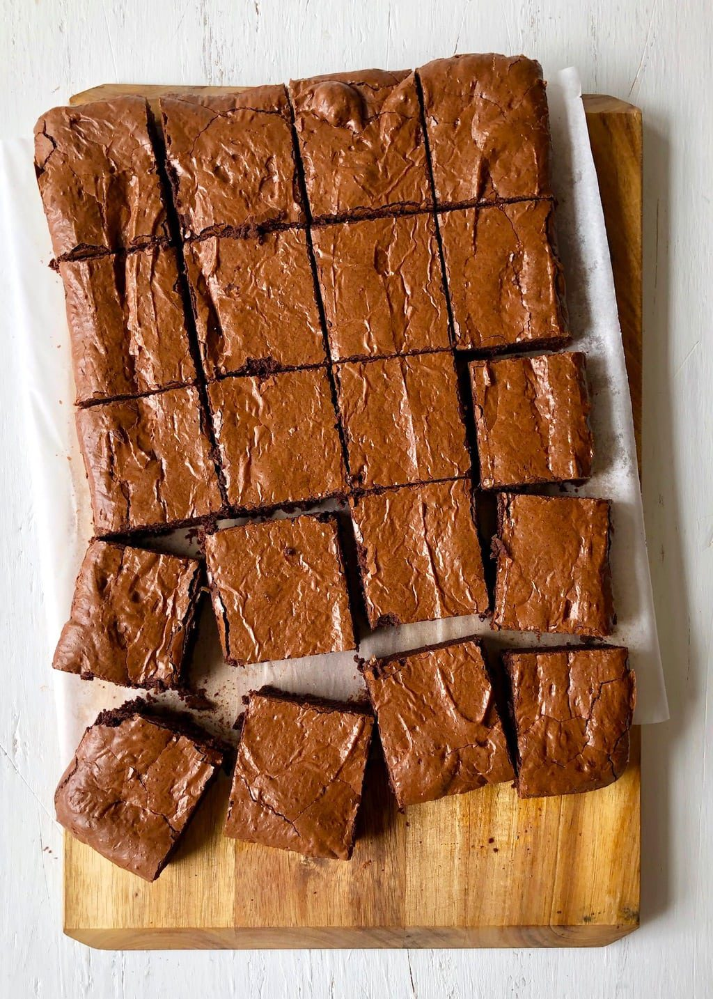 Cut brownies on parchment and cutting board