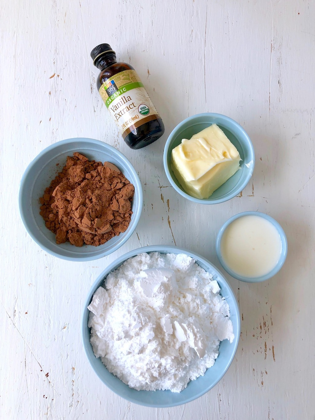 Cocoa powder, vanilla, butter, milk, and confectioner's sugar
