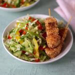 feature picture of sesame chicken and ginger cole slaw
