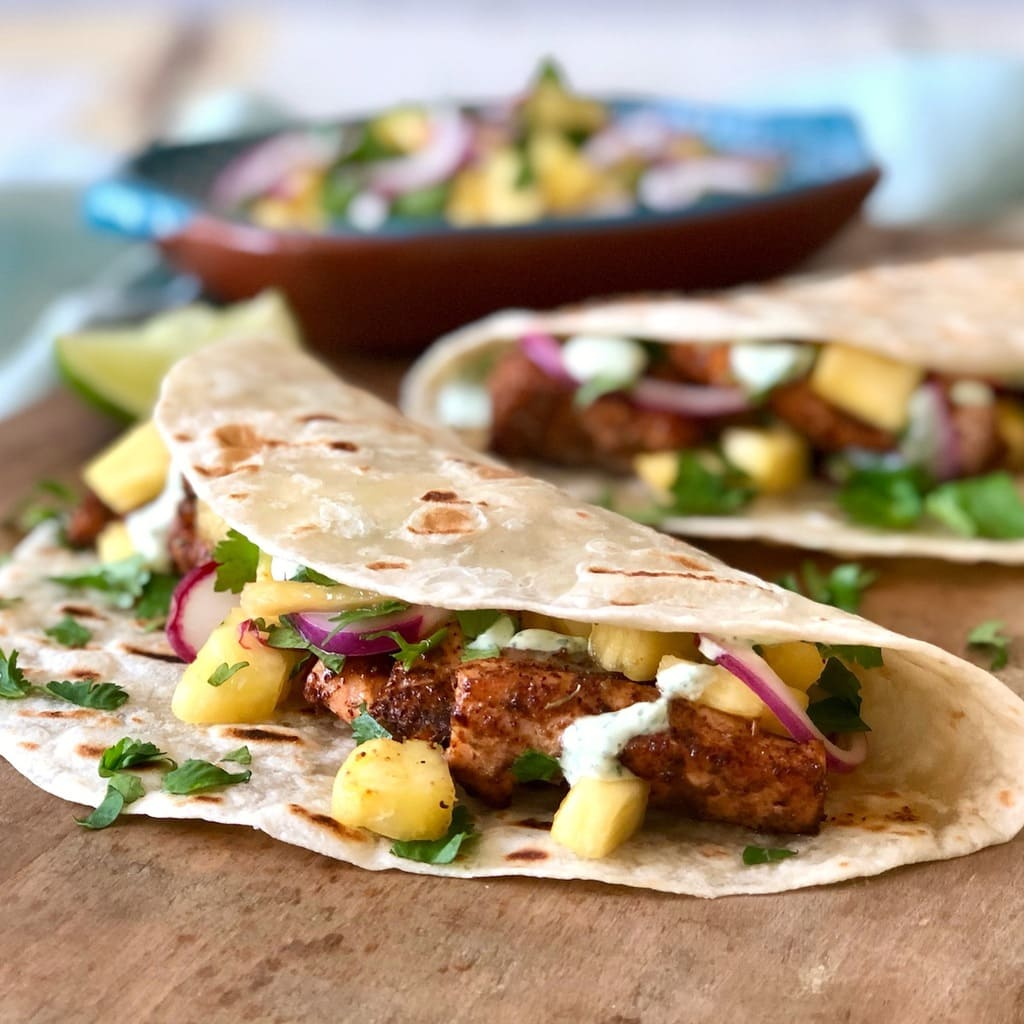 tacos featuring crema and pineapple salsa