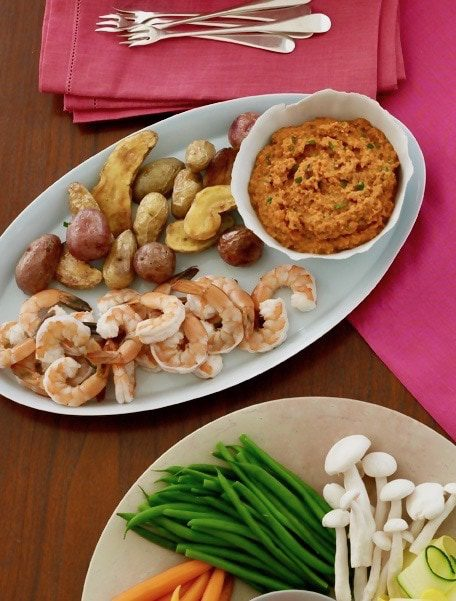 Spanish romesco dip with potatoes and shrimp with pink linen