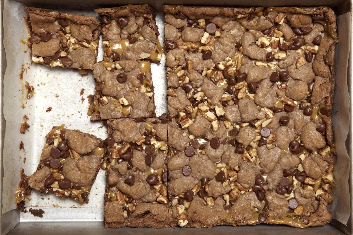 Gooey Caramel Brownies in a pan