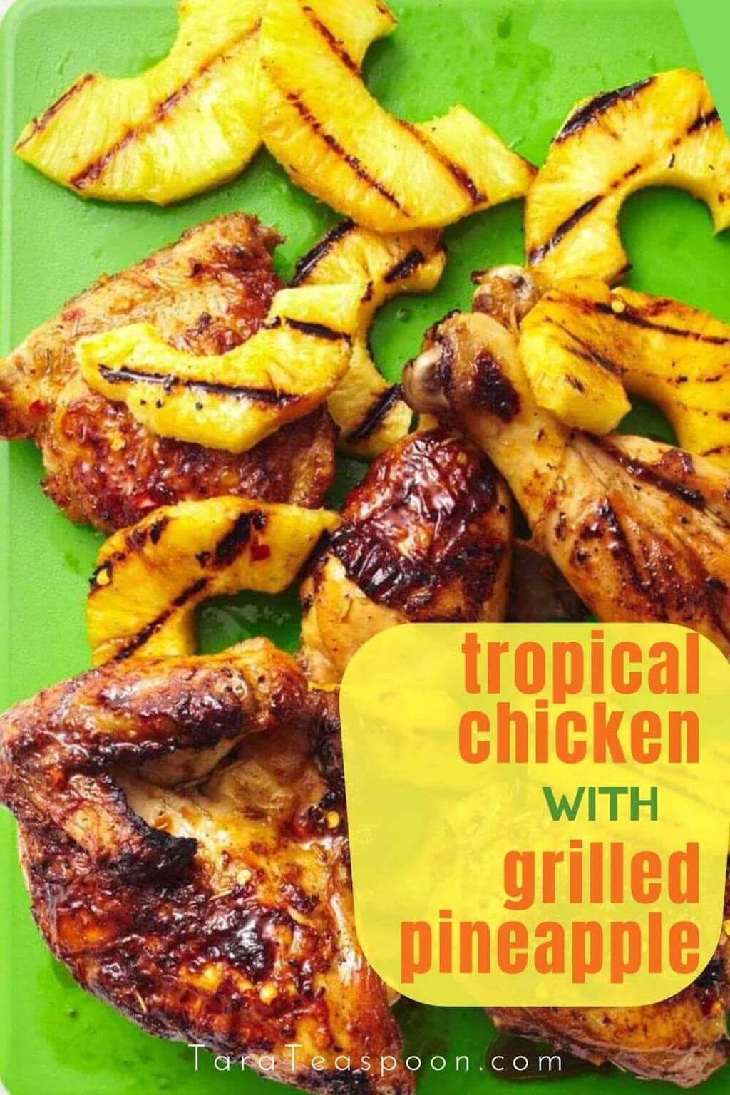 tropical chicken with grilled pineapple on green background