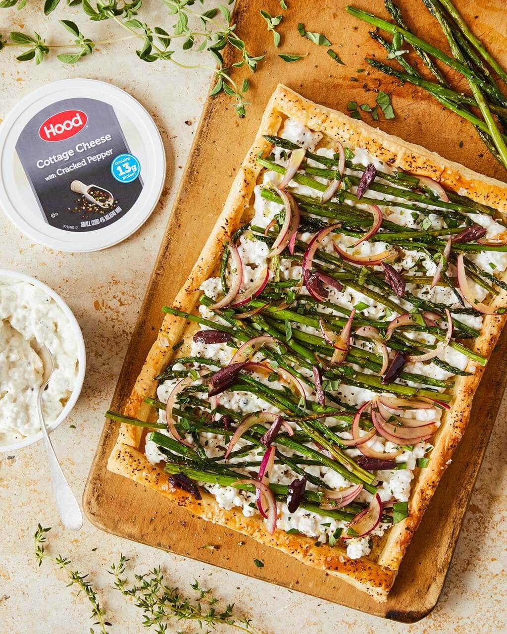 Asparagus Puff Pastry on cutting board with cottage cheese opened