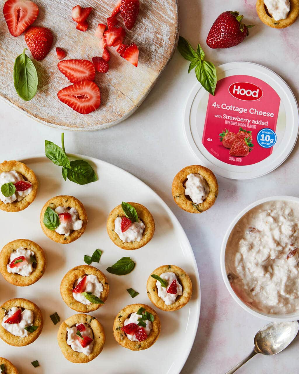 Sugar Cookie cups with strawberries and basil on a white platter