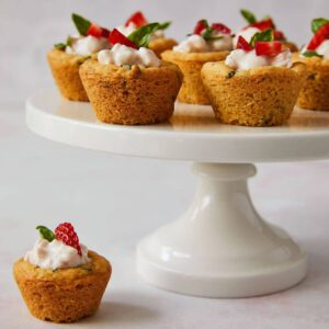 Strawberry basil sugar cookie cups on a cake pedistal