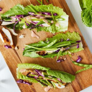 chicken lettuce wraps on a cutting board