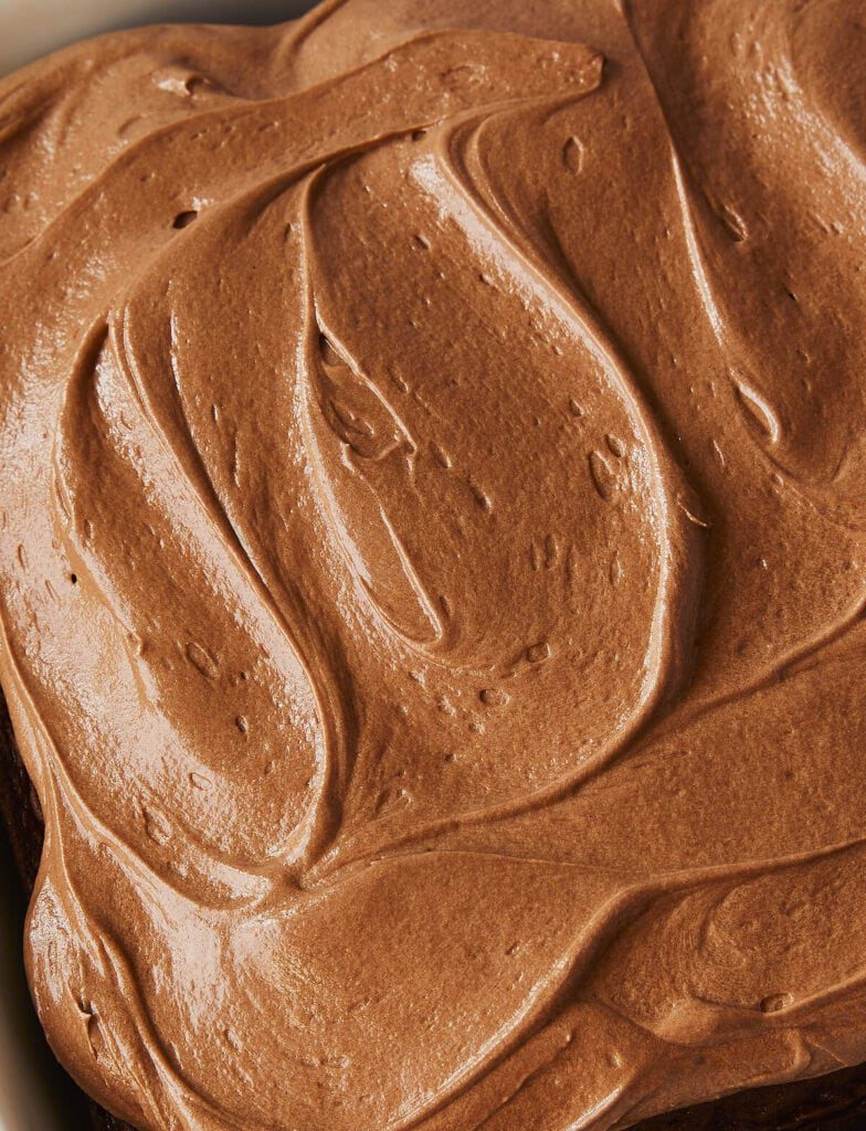 Close up of Chocolate Cream Cheese Frosting on square chocolate cake