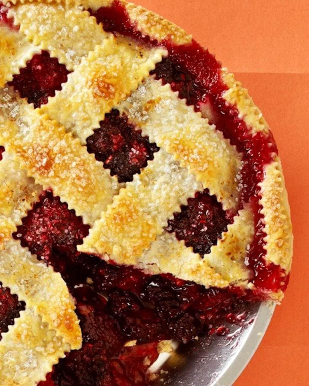 razzleberry pie with lattice top on orange paper