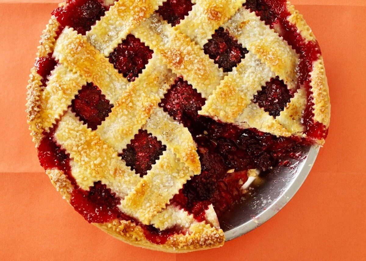 ginger razzleberry pie close up with slice out